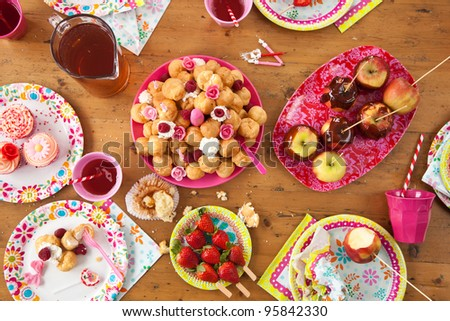 Birthday table with treats just after the party - stock photo