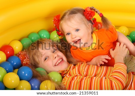 Birthday two girl in sport shirt with game ball. - stock photo