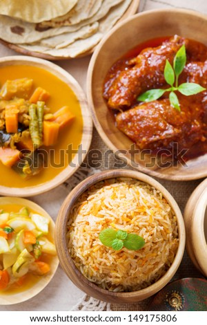 Biryani rice or pilaf rice with curry, fresh cooked basmati rice with spices, delicious Indian food. - stock photo