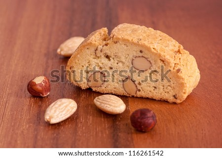 Biscotti with nuts on wood background - stock photo