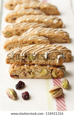 Biscotti  with pistachio and cranberry.  selective focus, shallow dof - stock photo