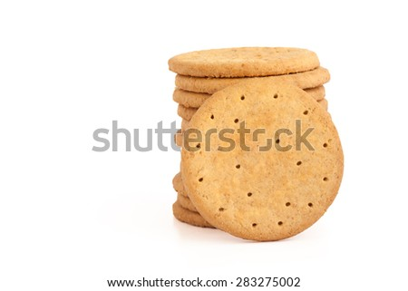 BISCUITS - A stack of delicious wheat round biscuits isolated on white - stock photo