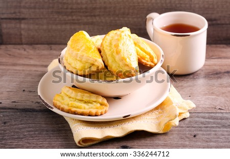 Biscuits filled with cheese in a bowl