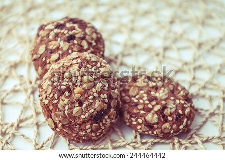 biscuits oats oatmeal cookies baking cereal home tasty napkin preparation cooking flour seeds grain snack meal  - stock photo