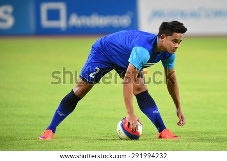 BISHAN,SINGAPORE-JUNE1:  Peerapat Notechaiya of Thailand in action before the 28th SEA Games Singapore 2015 match between Thailand and Timor Leste at Bishan Stadium on JUNE1 2015 in,SINGAPORE - stock photo