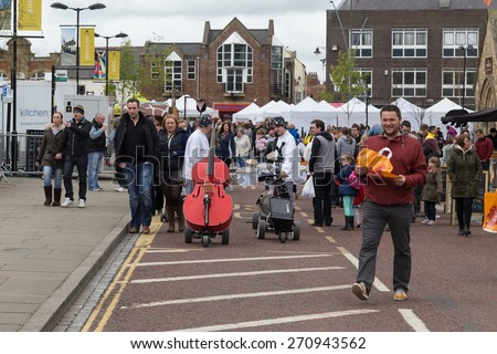 BISHOP AUCKLAND, ENGLAND - April 19, 2015: People Shopping in Bishop Auckland Food Festival. Bishop Auckland Food Festival is organised by Durham County Council.
