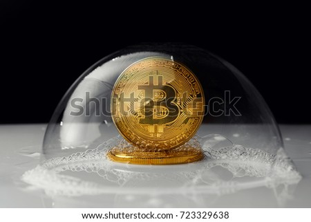 bitcoin in a soap bubble on black background