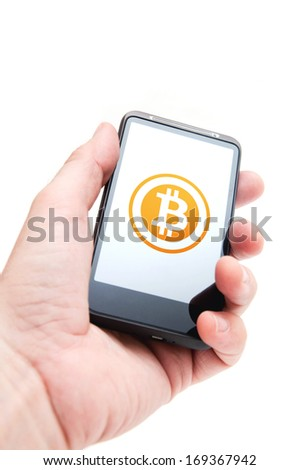 Bitcoin on mobile phone. Smart phone mobile device with bitcoin currency symbol in hands of caucasian businessman. - stock photo