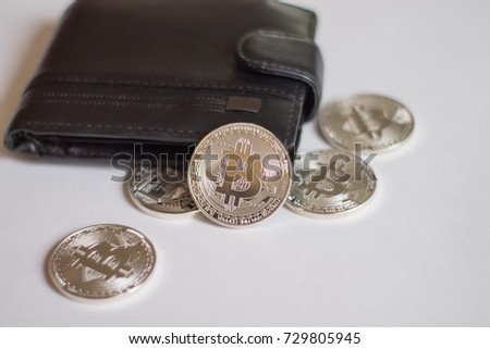 Bitcoins wallet coins located near wallet stock photo edit now bitcoins from the wallet coins are located near the wallet on a light background ccuart Choice Image