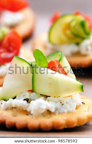 Bite size canapes with ricotta cheese and zuchinni - stock photo
