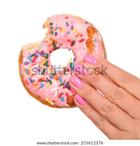 Bitten Donut with Sprinkles in Woman Hand isolated on white - stock photo