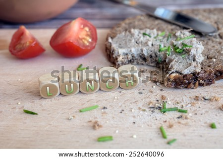 Bitten Off Wholemeal Bread With Spread For Lunch - stock photo