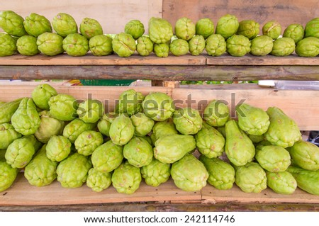 Bitter gourd or Chayote on wood in farms of agriculturist. - stock photo