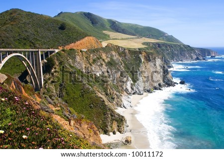 Bixby bridge in Big Sur area on the California coast with turquoise waters crashing on the shore. - stock photo