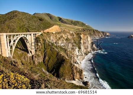 Bixby Creek Bridge is a reinforced concrete open-spandrel  arch bridge in Big Sur, California. - stock photo