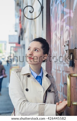 biz lady after working concept, elegant woman in a beige coat