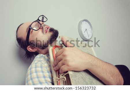 Bizarre Man sleeps in a waiting room chair - stock photo