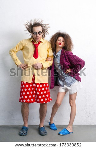 Bizarre pair of lovers in funny clothes  - stock photo