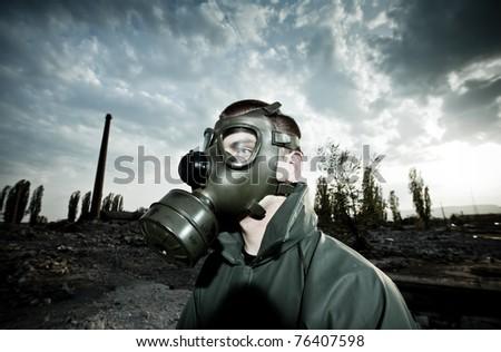 Bizarre portrait of man wearing gas mask - stock photo