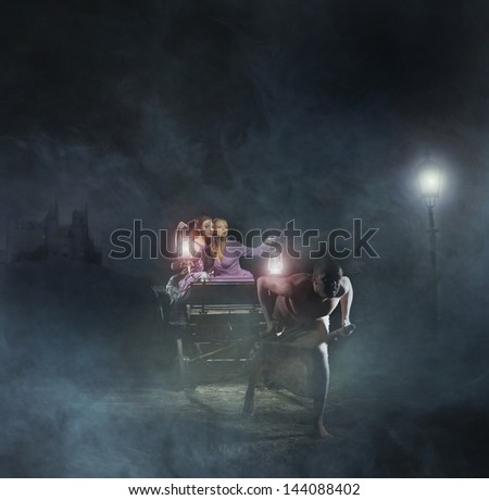 Bizarre, young, sexy women and the slave over the mystical background - stock photo