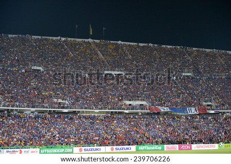 BKK,THA-DEC.16:Thai fans cheer during the competition 2014 AFF Suzuki Cup between Thailand and Philippines at Rajamangala stadium on December 10, 2014 in Bangkok, Thailand.