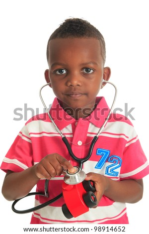 Black African American child with stethoscope and car isolated metisse hair curly - stock photo