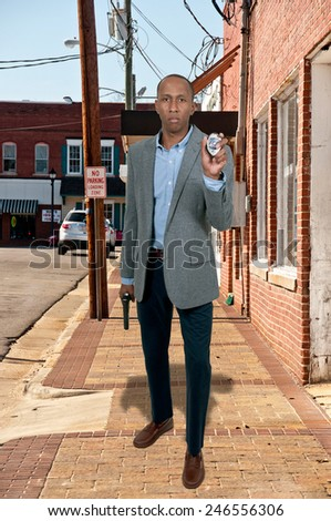 Black African American police detective man on the job with a gun - stock photo