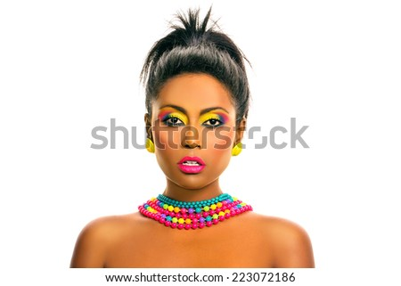 Black african beautiful model with colorful rainbow make up, hairstyle and accessories. Isolated, over white background, with copy space. - stock photo
