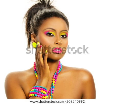Black african beautiful model with colorful rainbow make up, manicure, hairstyle and accessories. Isolated, over white background, with copy space. - stock photo