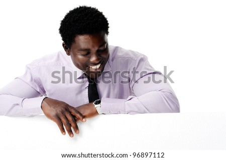 Black african businessman standing with a blank empty board providing copyspace for any advertising material. - stock photo
