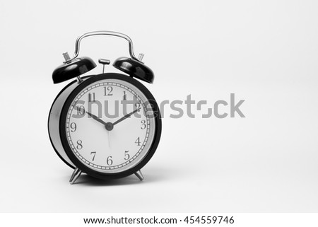 Black alarm clock at 10:10 o'clock isolate on white background