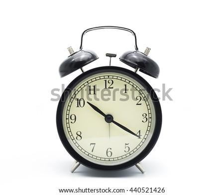 Black alarm clock isolated on white - stock photo