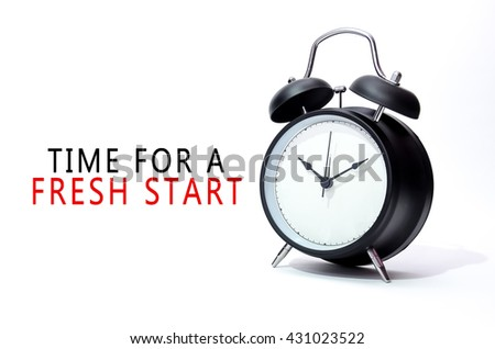 Black alarm clock isolated on white background with word Time For A Fresh Start. Concept of Time. - stock photo
