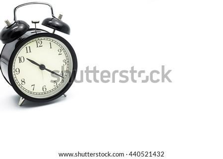 Black alarm clock isolated on white,Clock concept. - stock photo