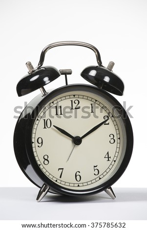 Black Alarm clock on plain background