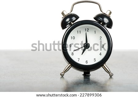 Black alarm clock on the table - stock photo