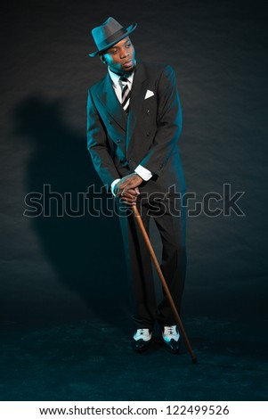 Black american mafia gangster man in suit. - stock photo