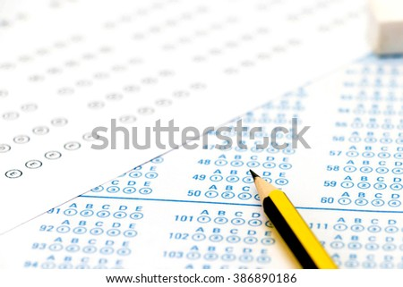 black and blue colour of blank answer sheets on table