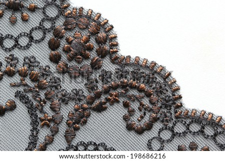 Black and brown flower lace material texture macro shot