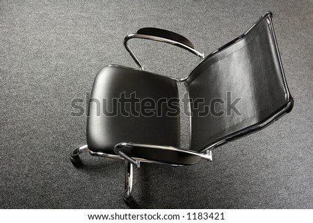 black and chrome office chair - stock photo