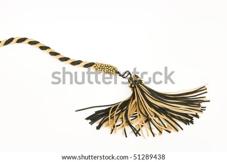 Black and gold cord with tassel. - stock photo