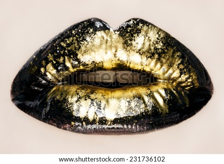 Black and gold lips close up, macro photography - stock photo