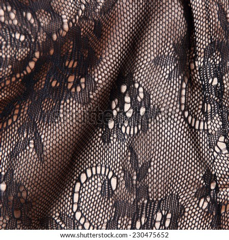 Black and golden fabric with ornament - stock photo