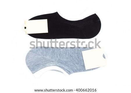 Black and gray men's socks on white background - stock photo