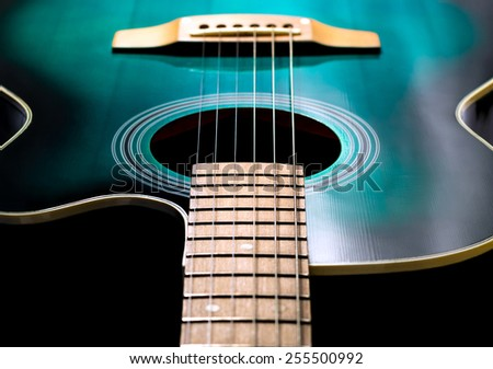 black and green color acoustic guitar - stock photo