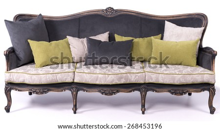 black and ivory sofa bed with black white and green pillows isolated on a white background - stock photo