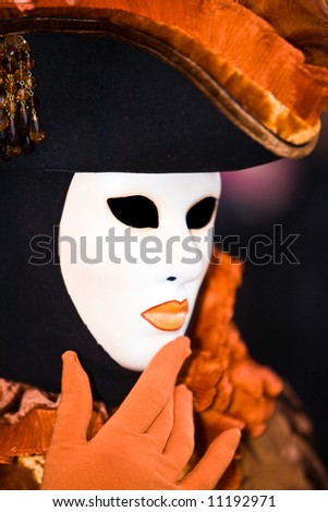 Black and orange costume at the Venice Carnival