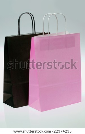 Black and Pink paper shopping bags - stock photo