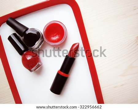 black and red cosmetics, make up - stock photo