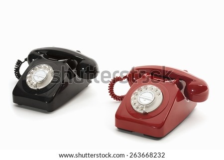 black and red rotary phones - stock photo